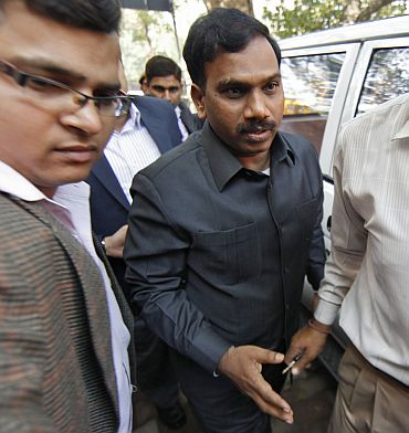 Raja (C) arrives at a court for a hearing in New Delhi on February 17