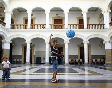 Refugee boys play at the courtyard of the Foreign Ministry headquarters in Caracas