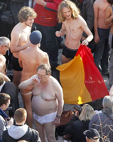 No government? Protestors do a striptease!