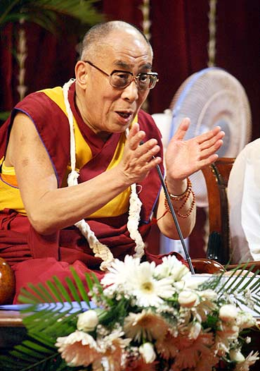 The Dalai Lama interacts with students at the Mumbai university