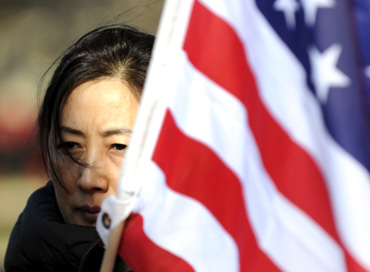 A pro-democracy activist protests against Chinese President Hu Jintao's visit to the US