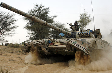 An Indian army tank moves during an army exercise in Rajasthan