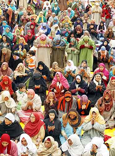Kashmiri women pray in the compound of Hazratbal shrine during Eid-e-Milad