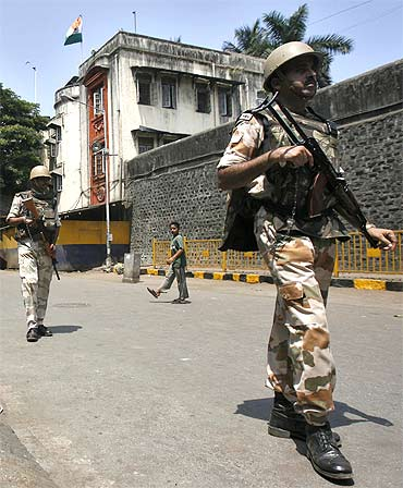 Paramilitary troops patrol outside Arthur Road Jail