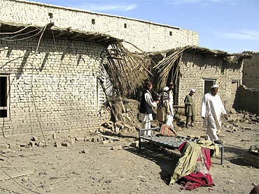 Tribesmen gather at the site of a US drone attack on the outskirts of Miranshah, near the Afghan border in Pakistan