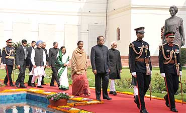 President Pratibha Patil, Prime Minister Manmohan Singh, Speaker Meira Kumar, Rajya Sabha Chairman Hamid Ansari, Union Minister Pawan Kumar Bansal  being led in a ceremonial procession to Parliament for the budget session
