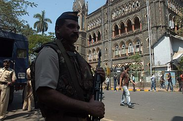 Police personnel stand guard in front of the Bombay high court on Monday