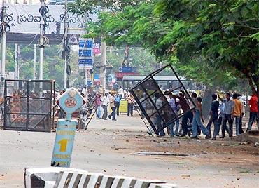 TSJAC members remove police barricades as they clash with RAF personnel on Monday