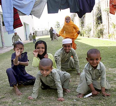 Children, orphaned by post-Godhra riots, play at an orphanage in Anjar, Gujarat