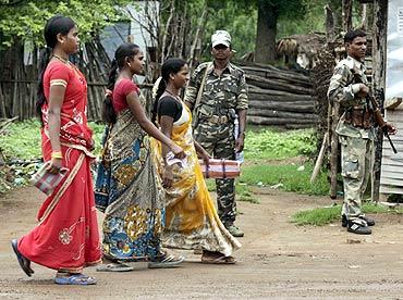 Paramilitary personnel stand guard in Awapalli, Chhattisgarh