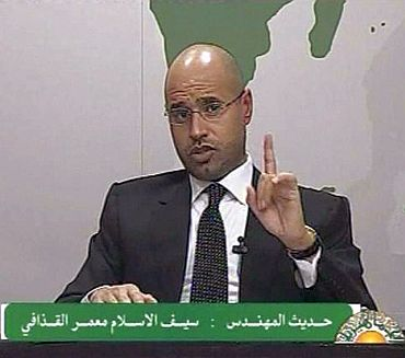 Saif al-Islam, son of Libyan leader Muammar Gaddafi, gestures as he speaks during an address on state television in Tripoli, in this still image taken from video