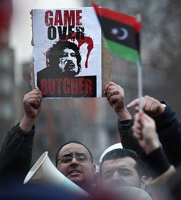 Gaddafi regime totters; 'Massacre' in Tripoli