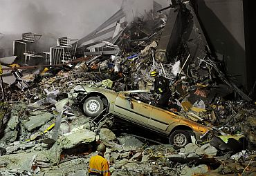 Rescue workers are seen at the collapsed C