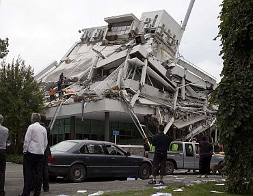Rescue crews look for staff in the damaged Pyne Gould Guinness building in central Christchurch after the earthquake