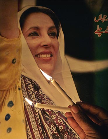 Benazir Bhutto's supporters light candles to celebrate her birthday in Islamabad.