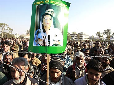 Benazir Bhutto's supporters gather for a memorial in Rawalpindi.