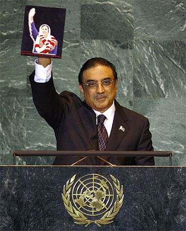 Pakistan President Asif Ali Zardari with a picture of his late wife Benazir at the United Nations.