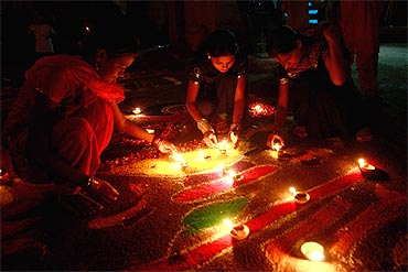 Devotees light oil lamps in a temple in Karachi