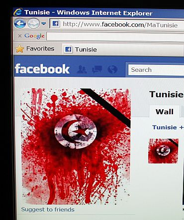 A student-run facebook page shows an image depicting the Tunisian national flag smeared in red, representing blood as seen on a computer screen