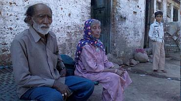 Nafeesa with her husband Anwar Ansari,outside their home in Godhra