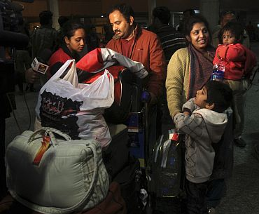 Indian family residing in Libya arrives at the airport in New Delhi