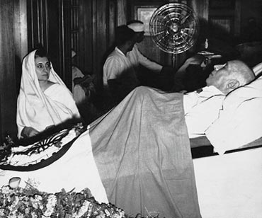 Indira Gandhi watching over her father's body at Teen Murti Bhavan, Delhi