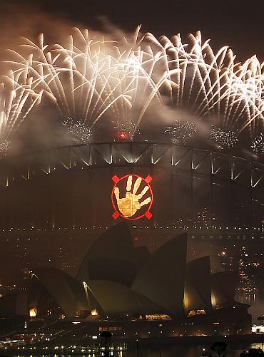 Fireworks explode over the Sydney Harbour Bridge and Opera House during a pyrotechnic show to celebrate the New Year