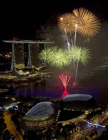 Fireworks explode over Marina Bay in front of the Marina Bay Sands casino and resort during a pyrotechnic show to welcome the new year in Singapore