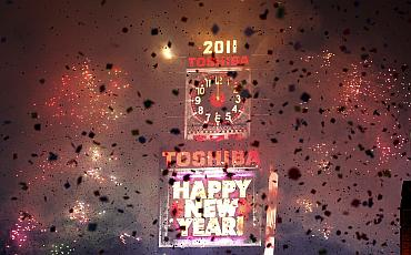 Confetti falls on revellers at midnight during New Year celebrations in Times Square in New York