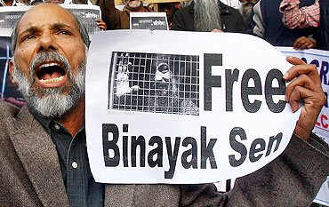 A demonstrator holds a placard as he shouts slogans during a protest demanding the release of Dr Binayak Sen