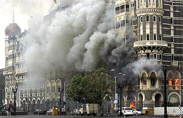 The Taj Mahal hotel is seen engulfed in smoke during a gun battle in Mumbai duirng 26/11 attacks
