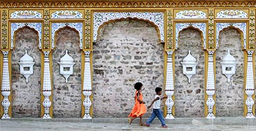 Pakistani children play outside an old Hindu temple
