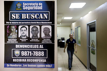 A wanted poster at a police station in Honduras for murderers of journalist David Meza Montecinos