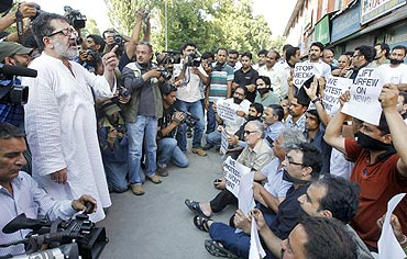 A senior journalist addresses members of the media during a protest in Srinagar on July 10, 2010