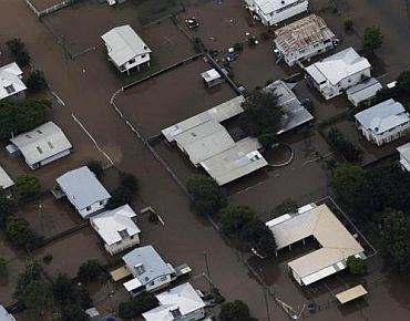 Buildings are submerged in floodwaters in a neighborhood in Rockhampton, Queensland
