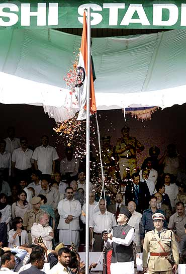 Jammu and Kashmir chief minister Omar Abdullah unfurls the national tricolour during Independence Day celebrations in Srinagar