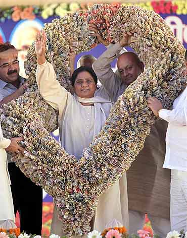 Uttar Pradesh Chief Minister Mayawati receives a garland made-of currency notes by her party supporters during a party workers meeting in Lucknow