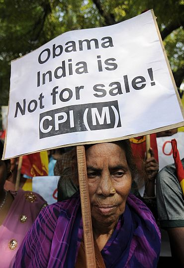 A CPI-M supporter holds a placard during a protest against US President Barack Obama's visit to India, in New Delhi