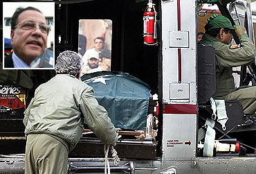 A military serviceman loads the casket containing the body of Punjab Governor Salman Taseer (inset) onto a helicopter after his funeral prayers at the Governor's House in Lahore