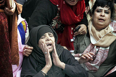 Supporters grieve during funeral prayers for Taseer