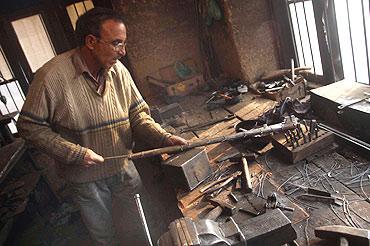 Zahoor fashions a gun at his factory