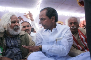 TRS chief KCR with BJP Leader Bandaru Dattatreya (right) and TPF president Gadar at a protest meet