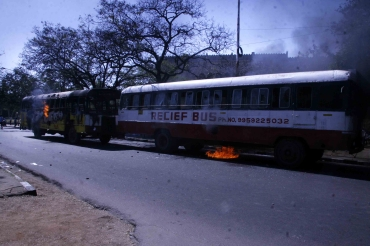 Pro-Telangana supporters set a bus on fire in Hyderabad