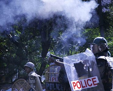 Policemen fire teargas shells at protestors