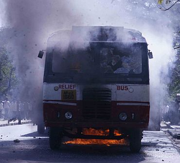 A bus is set alight by students of Osmania University