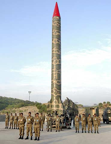 Pakistani soldiers stand near nuclear-capable ballistic Ghauri at an undisclosed location