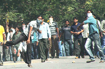 Pro-Telangana students of Osmania university hurl stones at security forces in Hyderabad on Friday