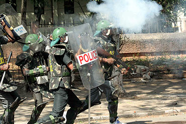 Policemen clash with protesting students at the campus on Friday