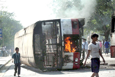 Pro-Telangana protestors burn a bus in Hyderabad on Friday