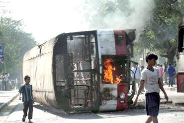 Pro-Telangana protestors burn a bus in Hyderabad on Friday
